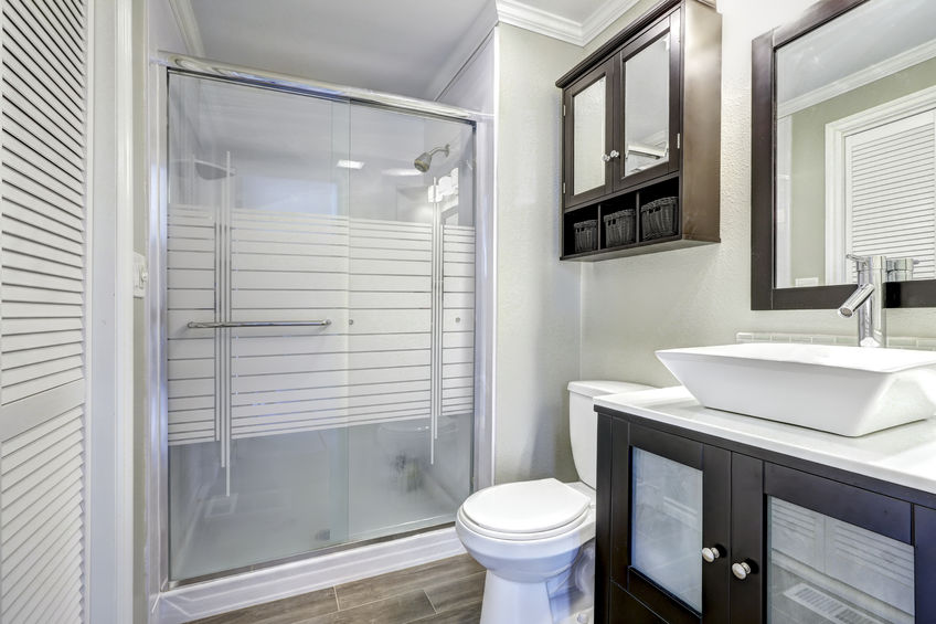 Modern bathroom interior with brown cabinets
