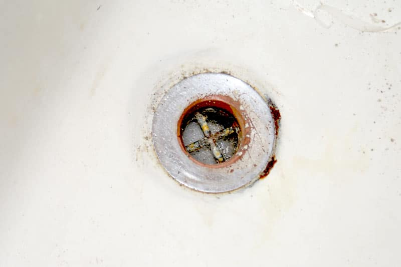 Old Tub Drain With Rust Forming Around And Underneath