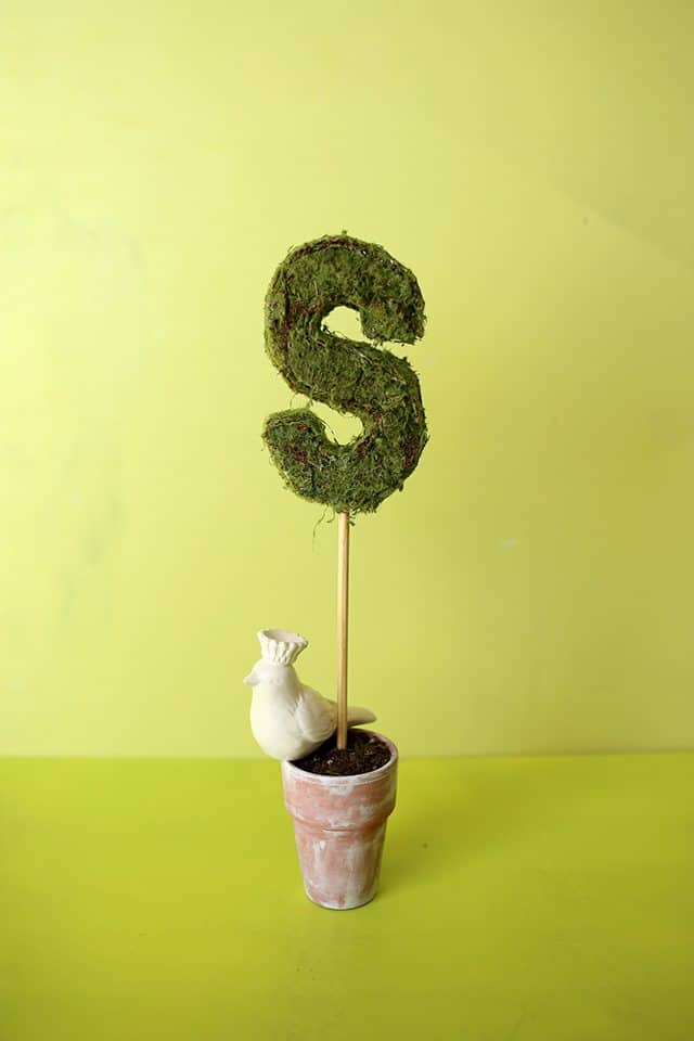 A custom topiary made from a chip board letter and moss.  Perfect for your garden party.