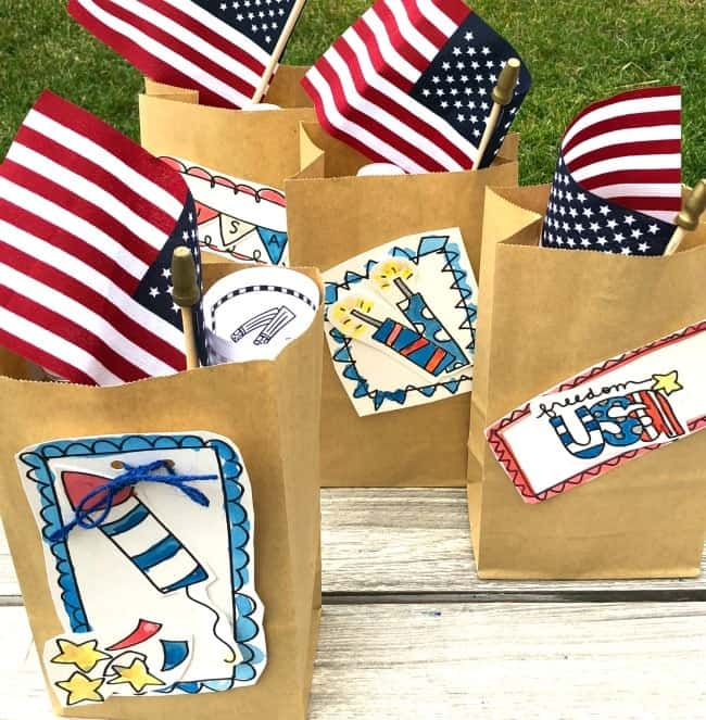 Paper bag goodie bags filled with 4th of July treats.