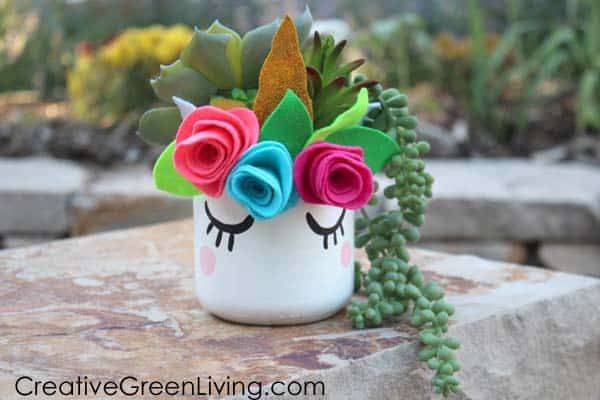 A unicorn mason jar succulent planter.
