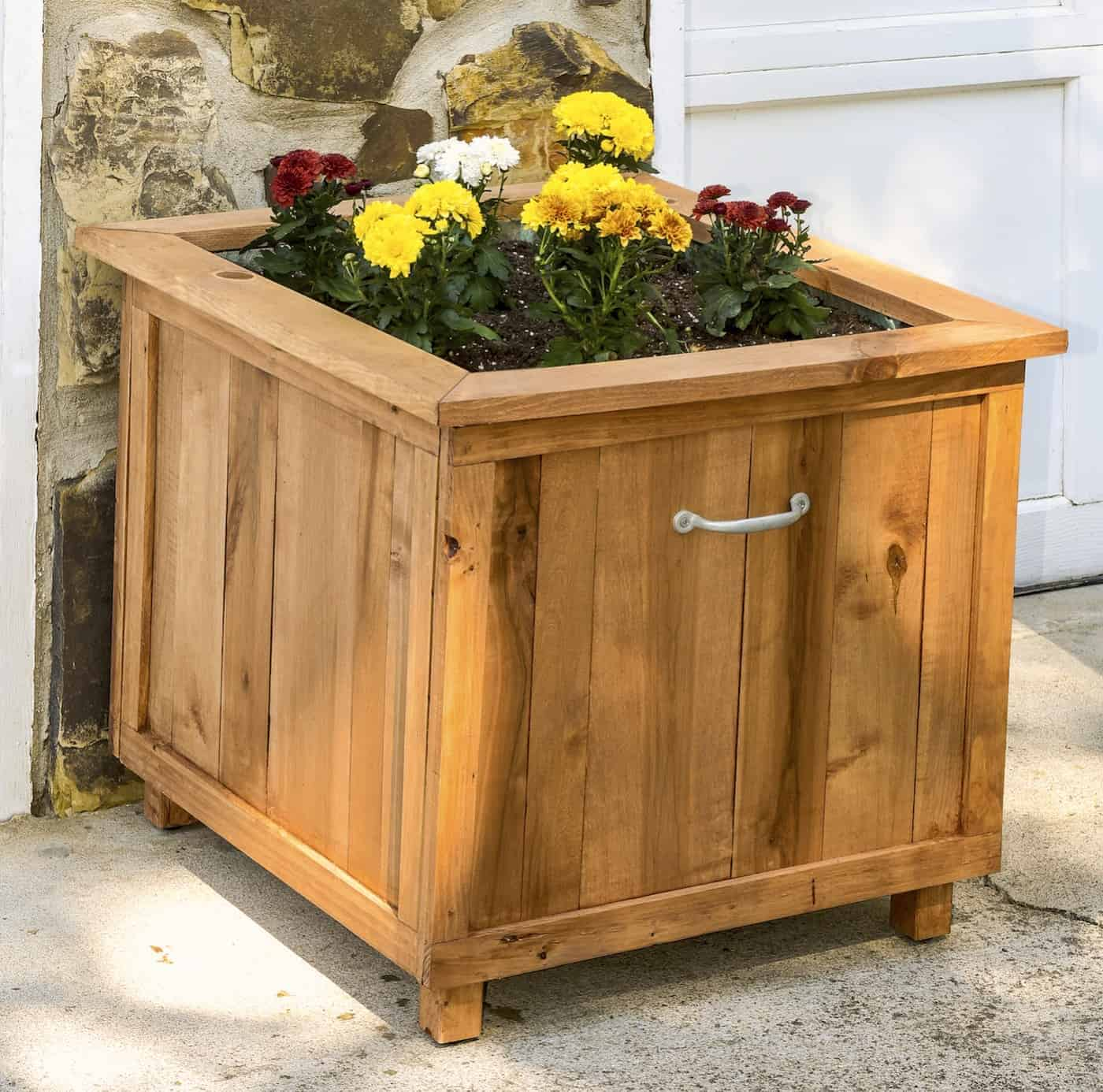 Hide your hose with this wooden storage bin and planter.