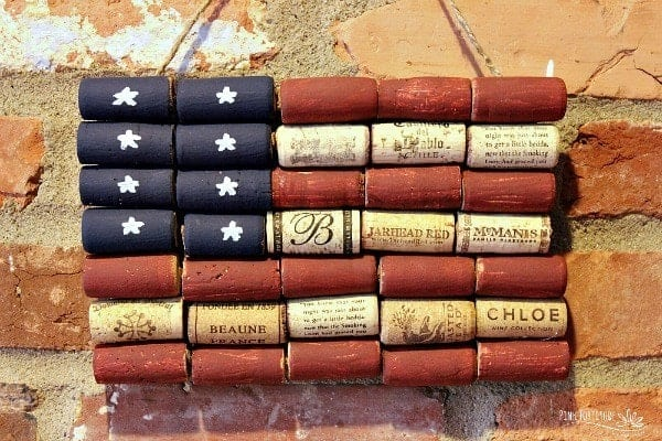 An American flag made out of painted wine corks.