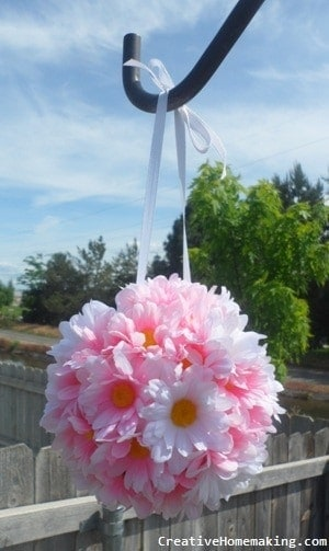 A fresh flower kissing ball made from fresh carnations.