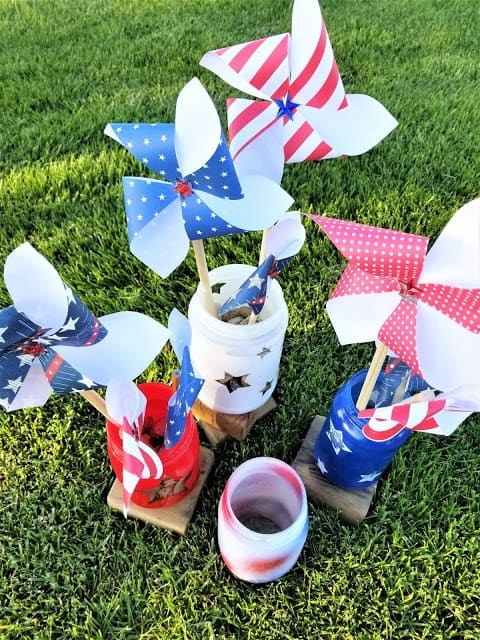 Red white and blue mason jars filled with pinwheels.