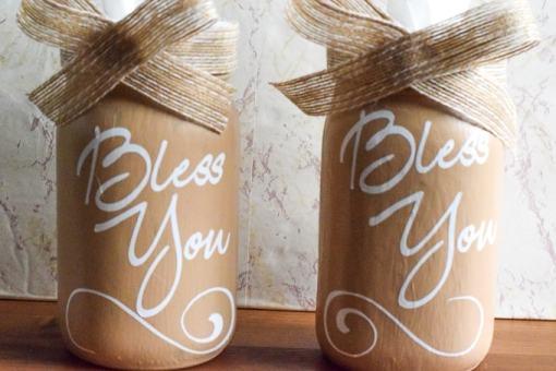 Two brown mason jar tissue dispensers