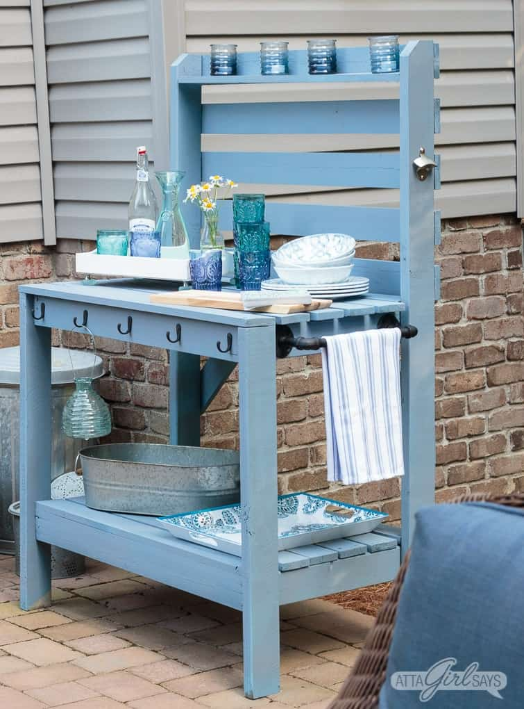 Up cycle an old potting bench with new paint and hardware.