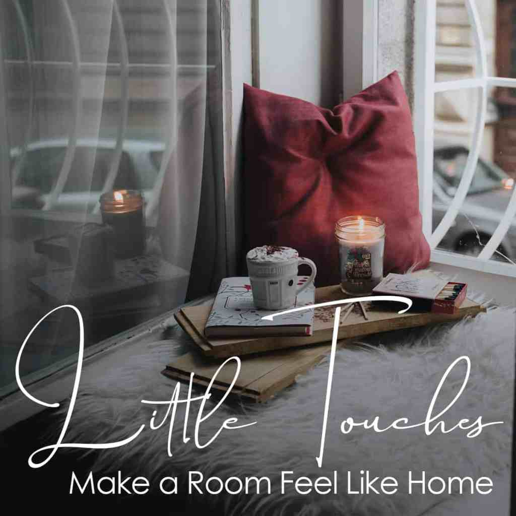 """A pillow and candle reading """"little touches make a room feel like home"""""""