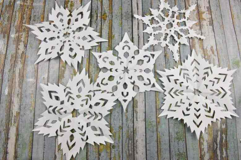 five different white paper snowflakes