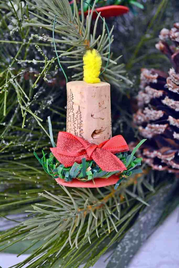 A candle ornament made from a wine cork.