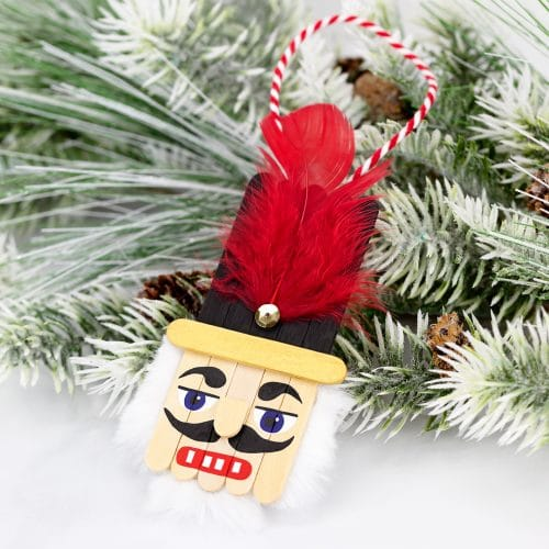 Popsicle sticks connected to make the face of a nutcracker. Easy ornament DIY
