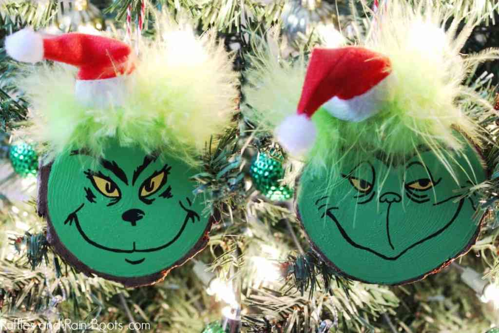Two green wood slice Grinch DIY ornaments