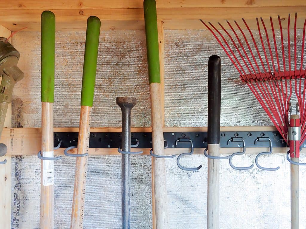 keep your garden tools organized with this rake and broom holder