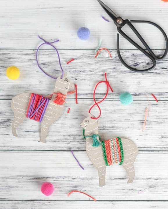 Some scissors, pom poms and a pretty decorated DIY llama ornament