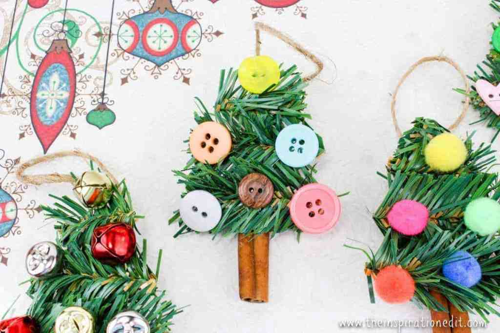 Christmas tree DIY ornaments made from cinnamon sticks and wreath garland.