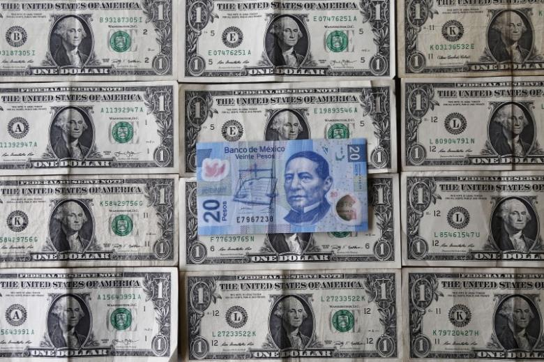 A picture illustration shows Mexican pesos and U.S. dollars banknotes in Mexico City