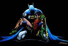 Batman Holding Jason Todd