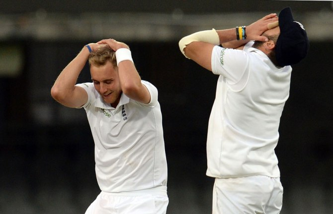 England hold their heads in disbelief after the final ball of the match fell just short of second slip