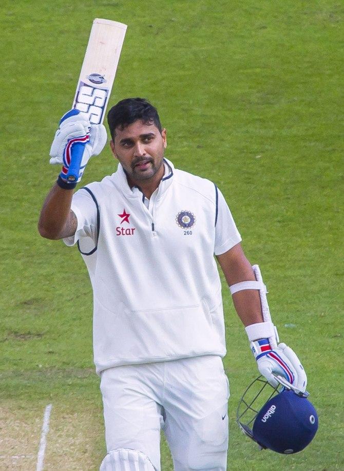 Vijay raises his bat after scoring a spectacular century