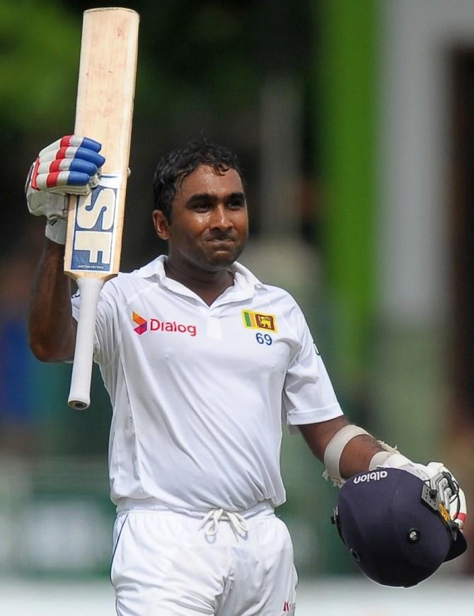 Jayawardene celebrates after bringing up his century