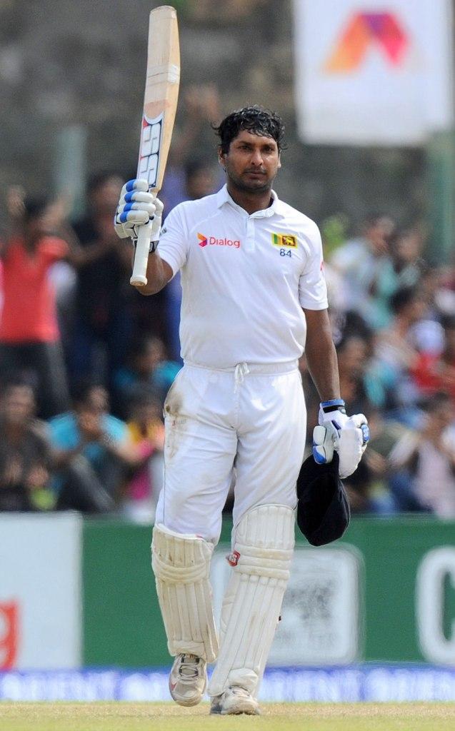 Sangakkara raises his bat after bringing up his 37th Test century