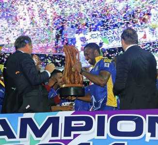 Pollard holds the trophy after his team won the CPL