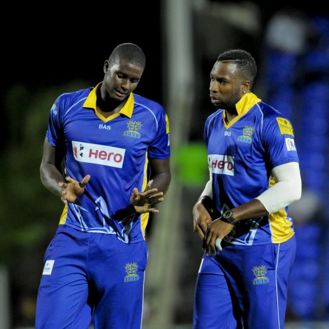 Holder (left) finished with figures of 4-27 off his four overs