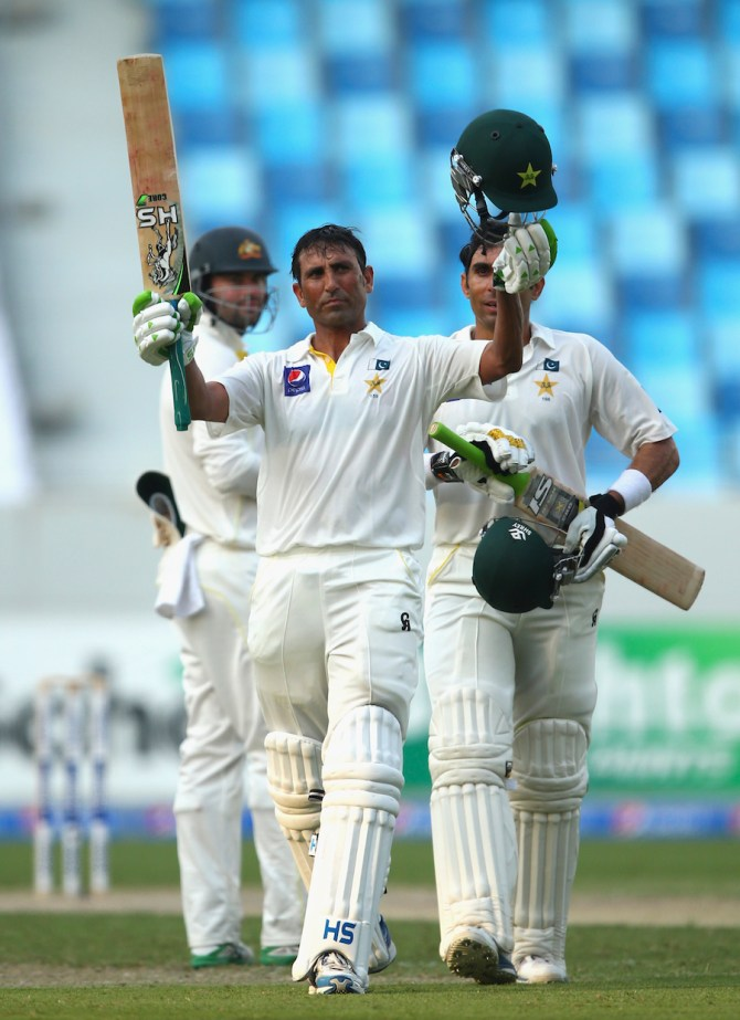 Khan celebrates after bringing up his 25th Test century