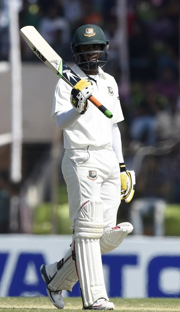 Hom celebrates after scoring his maiden Test half-century