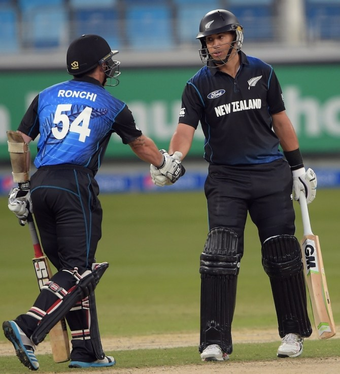 Taylor (right) shakes Ronchi's hand after scoring his 11th ODI century