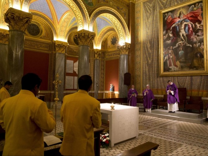 Members of the Vatican cricket team attend a memorial Mass held in honour of Hughes