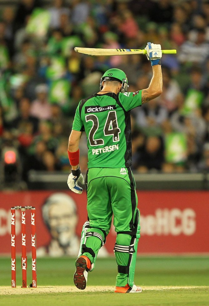 Pietersen raises his bat after bringing up his half-century