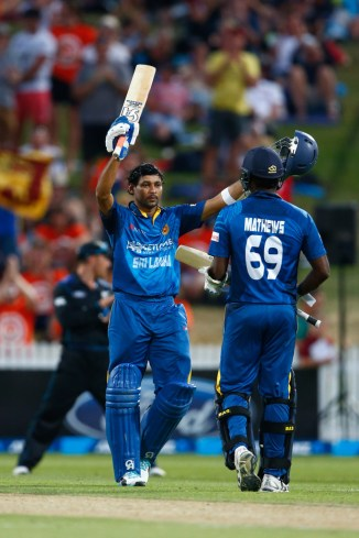 Dilshan celebrates after scoring his 19th ODI century