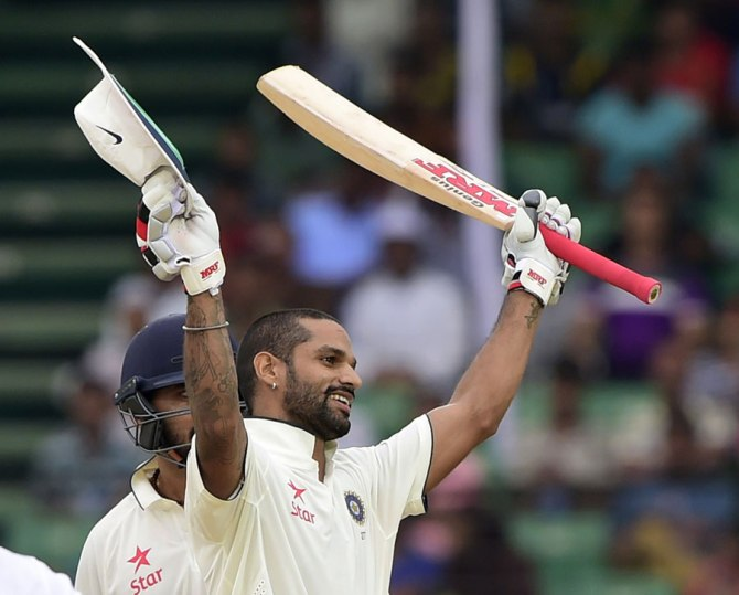 Dhawan celebrates after scoring his third Test century