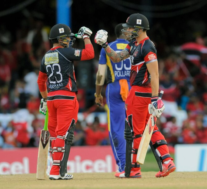 Akmal (left) and Delport (right) both made half-centuries