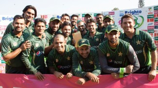 Pakistan celebrate after beating Zimbabwe 2-1