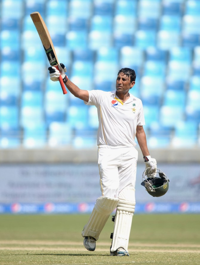 Khan celebrates after scoring his 31st Test century