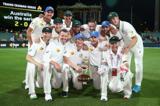 Australia celebrate after beating New Zealand 2-0