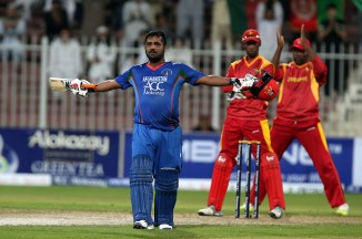 Shahzad celebrates after scoring his fourth ODI century