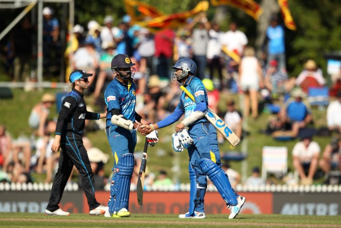 Dilshan (right) scored his 47th ODI fifty