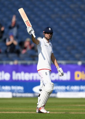 Cook celebrates after becoming the youngest, and 12th batsman overall, to score 10,000 Test runs