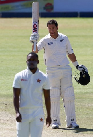 Taylor celebrates after scoring his 14th Test hundred