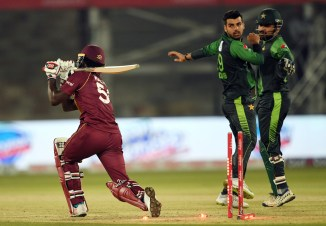 Shadab Khan fined 20 percent match fee demerit point pointing finger inappropriate comment dismissing Chadwick Walton Pakistan West Indies T20 series Karachi cricket