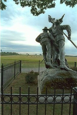 """North Carolina Monument. The view is from the Confederate position on Seminary Ridge. Looking straight ahead one can see the """"clump of trees"""" on the horizon marking the approximate centre of the Union line. (Copyright Allen Goodall 2003)"""
