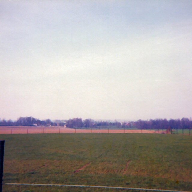 "The view from Bussy, looking towards the French position on ""their"" left. The line of the Ligny stream marked by the trees in the distance."