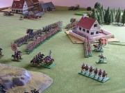The Grenouissian dragoons charge into Theobald's Cuirassiers, stopping them in their tracks.