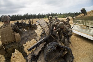 Marines deal with an obstacle.