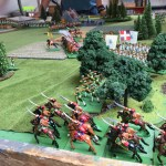 The Grenouissian chasseurs à cheval moving past their à pied colleagues in the woods. Here you can see how the light infantry have managed to send part of their unit forward into the eastern copse.