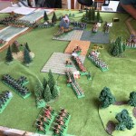 Now things are really hotting up, with substantial numbers of Borg across the river. The Grenouissian infantry are now exchanging volleys with their opponents in the farm, and chasseurs à pied in the southern woods are sniping at Borg hussars. Grenouissian fusiliers are marching briskly to plug the centre.