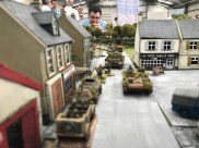Normandy 1944 staged in 20mm by Steve Jones using his 'simple Squad Leader' rules. (That's him eating the burger!)